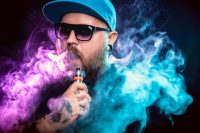 Man with beard vaping other drugs with smoke clouds
