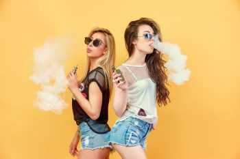 Young women enjoying vape liquids