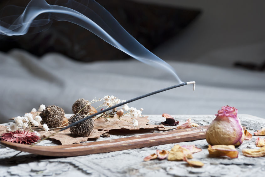 Picture of an incense stick burning with natural ingredients