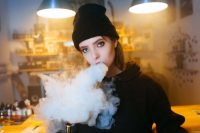 Girl with Hip Hop clothing for massive vaping article